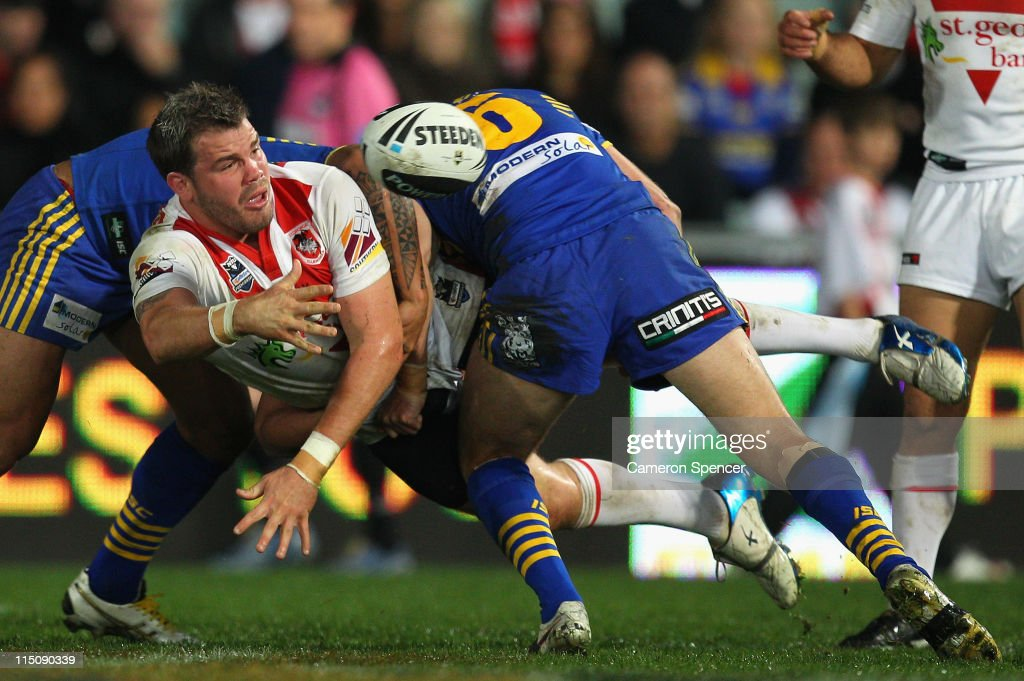 Adam Cuthbertson of the Dragons offloads the ball in a tackle during the round 13 NRL match between the Parramatta Eels and the St George Illawarra Dragons at Parramatta Stadium on June 3, 2011 in Sydney, Australia.
