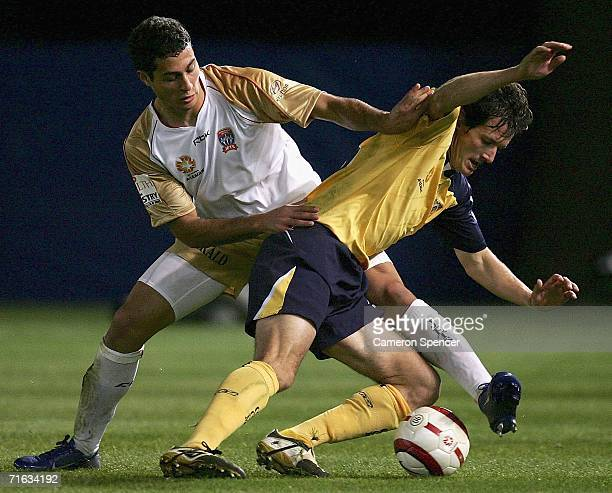Adam D'Apuzzo of the Jets contests the ball with Andrew Clark of the Mariners during the A-League Pre-Season Cup semi-final match between the Central...