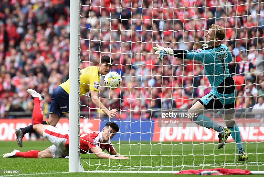 Adam Davies of Barnsley fails to save goal by Callum O'Dowda of Oxford United during the Johnstone's Paint Trophy Final match between Oxford United and Barnsley at Wembley Stadium on April 3, 2016 in London, England. (Photo by Tom Dulat/Getty Images).