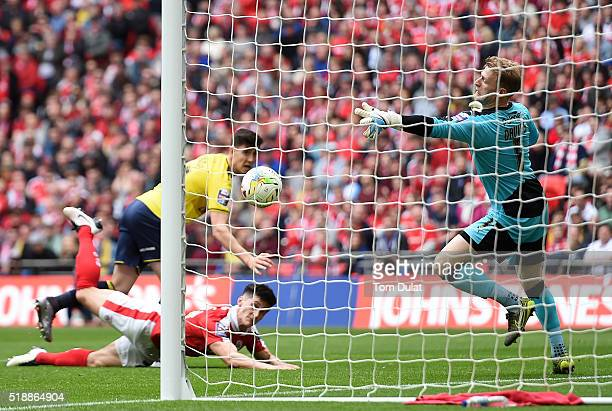 Adam Davies of Barnsley fails to save goal by Callum O'Dowda of Oxford United during the Johnstone's Paint Trophy Final match between Oxford United...