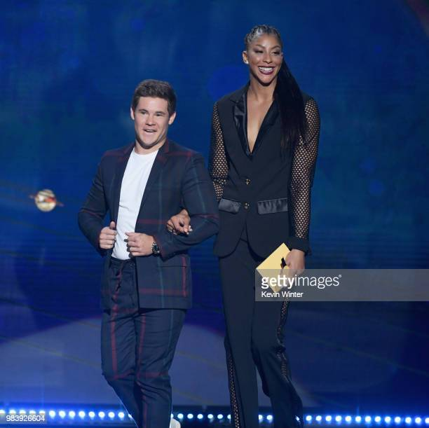 Adam DeVine and Candace Parker speak onstage at the 2018 NBA Awards at Barkar Hangar on June 25 2018 in Santa Monica California