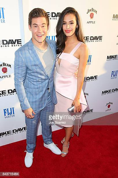 Adam Devine and Chloe Bridges arrive at Mike And Dave Need Wedding Dates Red Carpet Screening presented in partnership with FIJI Water on June 29...