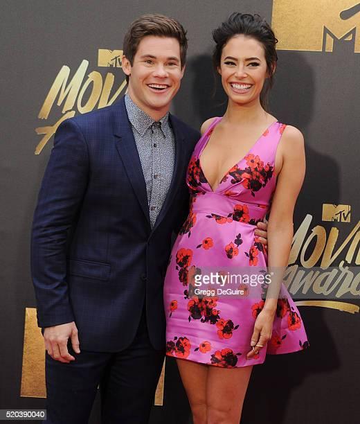Adam DeVine and Chloe Bridges arrive at the 2016 MTV Movie Awards at Warner Bros Studios on April 9 2016 in Burbank California