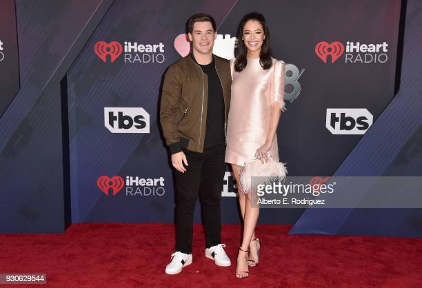 Adam DeVine and Chloe Bridges arrive at the 2018 iHeartRadio Music Awards which broadcasted live on TBS TNT and truTV at The Forum on March 11 2018...