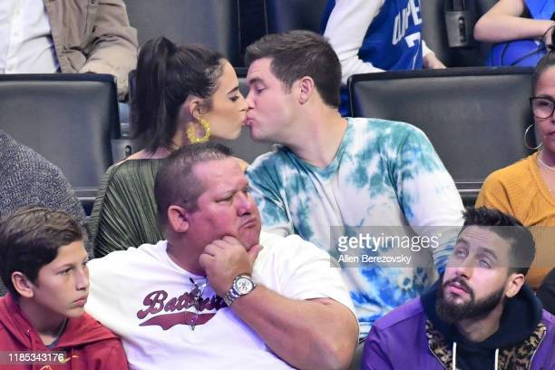 Adam DeVine and Chloe Bridges attend a basketball game between the Los Angeles Clippers and the Utah Jazz at Staples Center on November 03 2019 in...