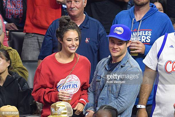 Adam DeVine and Chloe Bridges attend a basketball game between the Utah Jazz and the Los Angeles Clippers at Staples Center on October 30 2016 in Los...