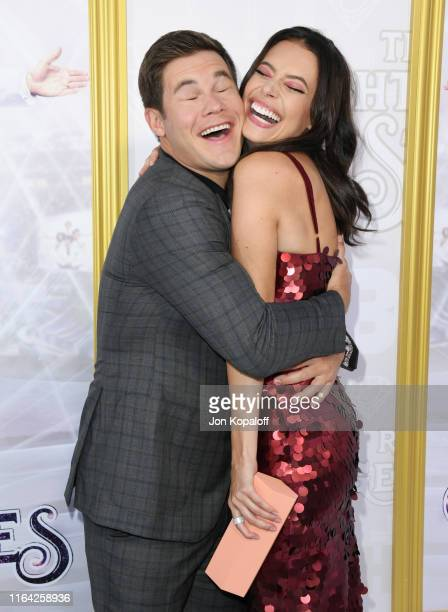 Adam DeVine and Chloe Bridges attend the Los Angeles Premiere Of New HBO Series The Righteous Gemstones at Paramount Studios on July 25 2019 in...