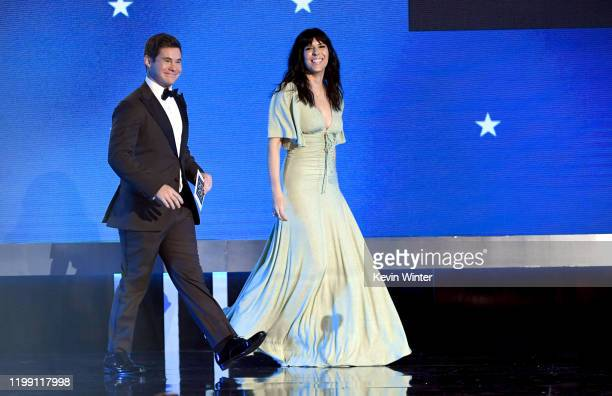 Adam DeVine and Edi Patterson walk onstage during the 25th Annual Critics' Choice Awards at Barker Hangar on January 12 2020 in Santa Monica...