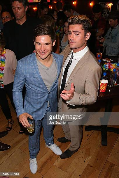Adam Devine and Zac Efron attend the 'Mike And Dave Need Wedding Dates' Screening Afterparty presented in partnership with FIJI Water on June 29 2016...