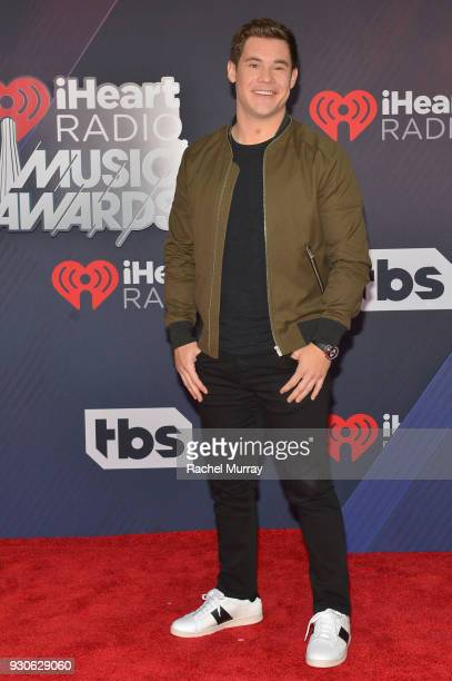 Adam DeVine arrives at the 2018 iHeartRadio Music Awards which broadcasted live on TBS TNT and truTV at The Forum on March 11 2018 in Inglewood...