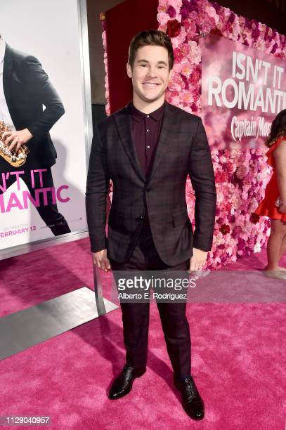Adam DeVine attends the premiere of Warner Bros Pictures' Isn't It Romantic at The Theatre at Ace Hotel on February 11 2019 in Los Angeles California