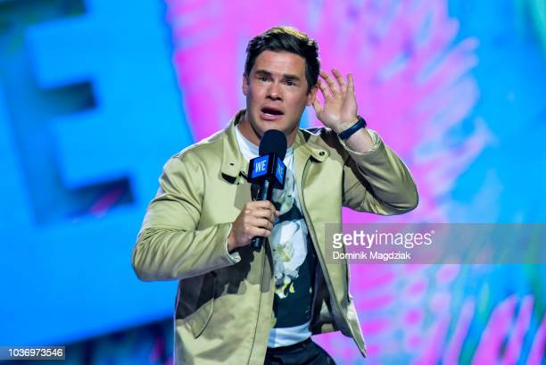 Adam Devine speaks on stage during the 2018 WE Day Toronto Show at Scotiabank Arena on September 20 2018 in Toronto Canada