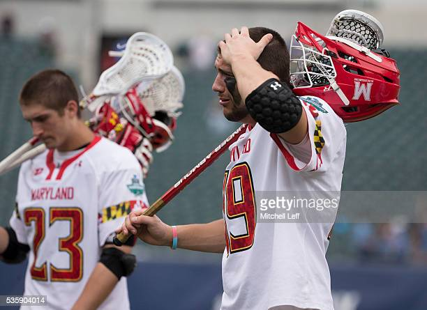 Adam DiMillo and Will Bonaparte of the Maryland Terrapins walk off the field after the game against the North Carolina Tar Heels in the NCAA Division...