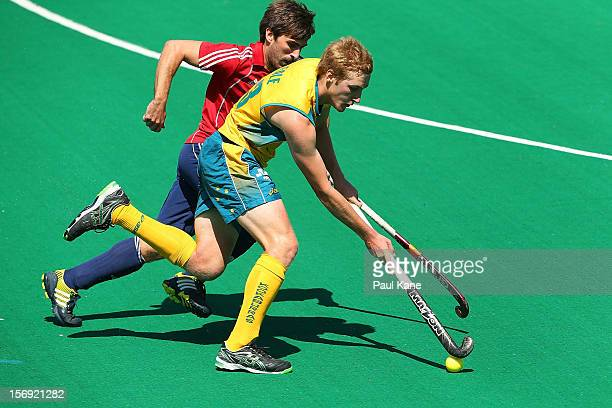 Adam Dixon of England tackles Daniel Beale of the Kookaburras in the gold medal match between the Australian Kookaburras and England during day four...