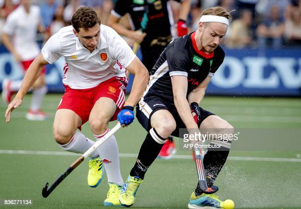 TOPSHOT Adam Dixon of England vies with Christopher Ruhr of Germany during the Men's EuroHockey Championships 2017 match between England and Germany...