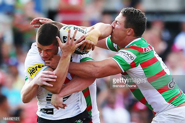 Adam Docker of the Panthers is tackled by Sam Burgess of the Rabbitohs during the round three NRL match between the Penrith Panthers and the South...