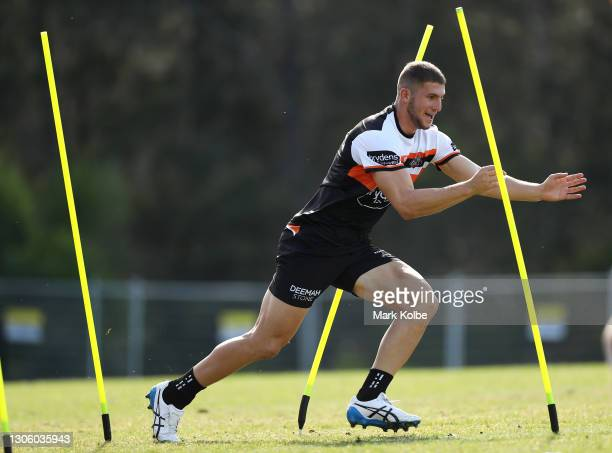 Adam Doueihi runs a drill during a Wests Tigers NRL training session at St Luke's Park North on March 09, 2021 in Sydney, Australia.