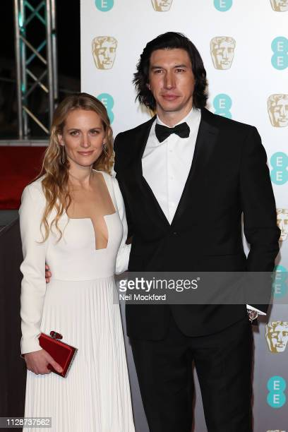 Adam Driver and Joanne Tucker attends the EE British Academy Film Awards at Royal Albert Hall on February 10 2019 in London England