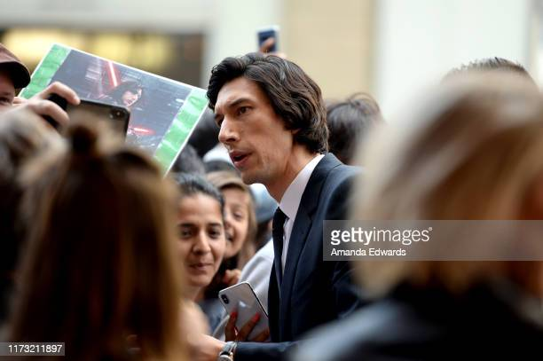 Adam Driver poses with fans at the Marriage Story premiere during the 2019 Toronto International Film Festival at Winter Garden Theatre on September...