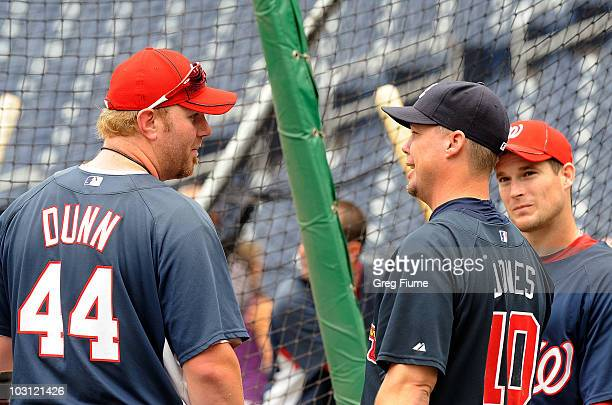 Adam Dunn and Josh Willingham of the Washington Nationals talk with Chipper Jones of the Atlanta Braves before the game at Nationals Park on July 27...