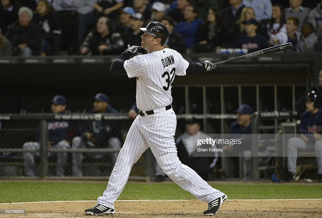 Adam Dunn #32 of the Chicago White Sox follows through on a three-run home run scoring Jordan Danks #7 and Kevin Youkilis #20 during the eighth inning against the Cleveland Indians at U.S. Cellular Field on September 24, 2012 in Chicago, Illinois. The White Sox defeated the Indians 5-4.