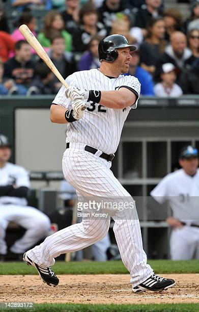 Adam Dunn of the Chicago White Sox follows through on an RBI double scoring Brent Morel during the sixth inning against the Detroit Tigers at US...