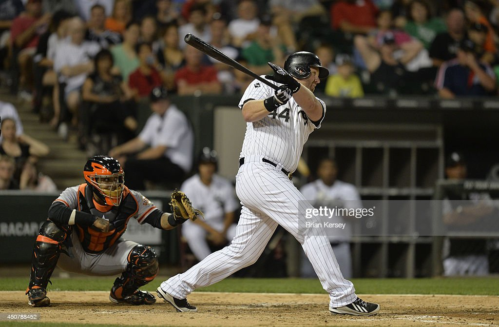 Adam Dunn #44 of the Chicago White Sox follows through on an RBI single scoring Conor Gillaspie as Hector Sanchez #29 of the San Francisco Giants catches during the fifth inning at U.S. Cellular Field on June 17, 2014 in Chicago, Illinois.