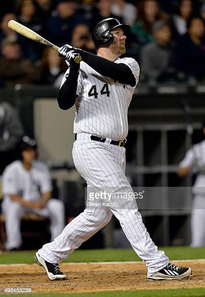 Adam Dunn of the Chicago White Sox follows through on his gamewinning tworun home run scoring Moises Sierra during the ninth inning against the New...