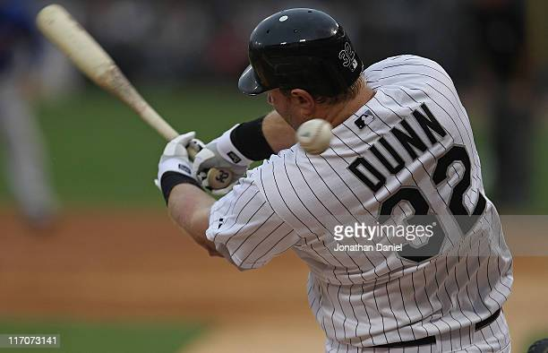 Adam Dunn of the Chicago White Sox fouls off a pitch against the Chicago Cubs at US Cellular Field on June 20 2011 in Chicago Illinois The Cubs...