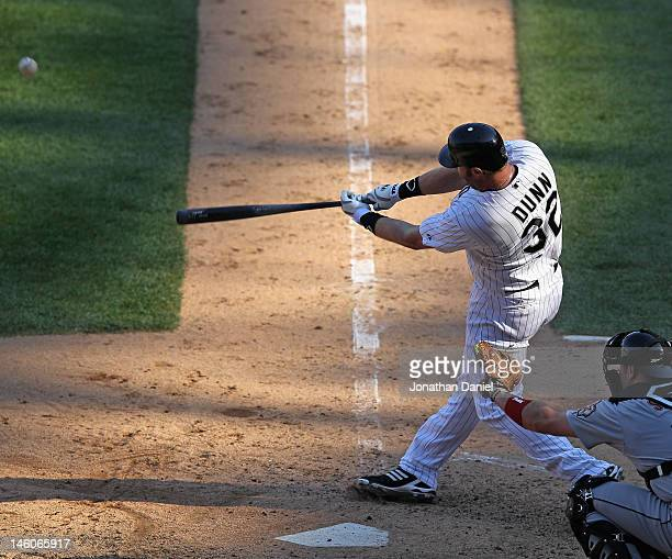 Adam Dunn of the Chicago White Sox hits a grand slam home run in the 8th inning against the Houston Astros at US Cellular Field on June 9 2012 in...