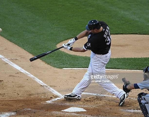 Adam Dunn of the Chicago White Sox hits a tworun home run in the 1st inning against the Detroit Tigers at US Cellular Field on July 26 2011 in...