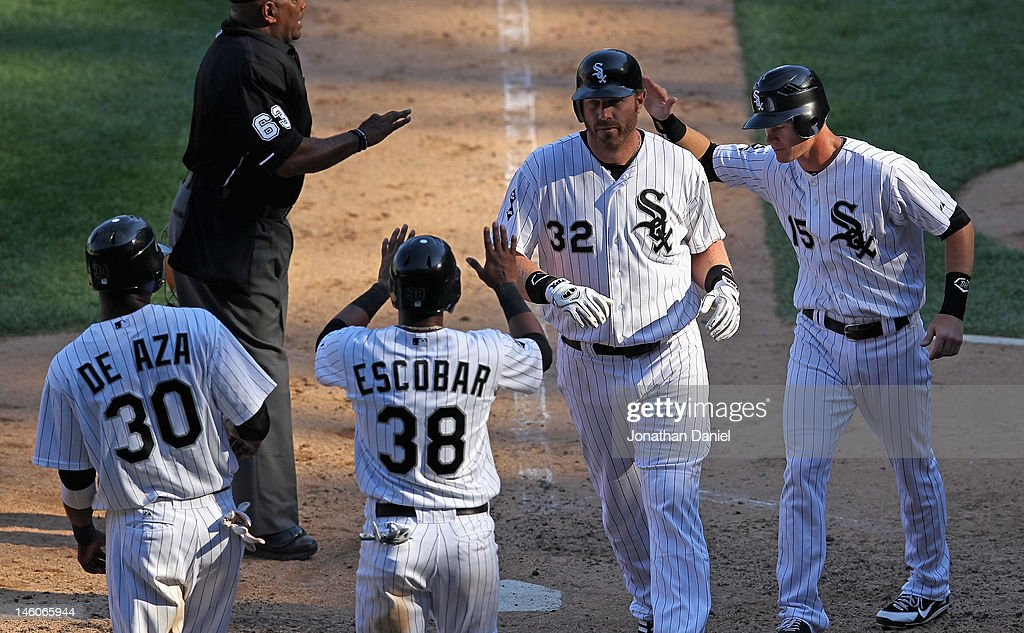 Adam Dunn #32 of the Chicago White Sox is greeted by (L-R) Alejandro De Aza #30, Eduardo Escobar #38 and Gordon Beckham #15 after hitting a grand slam home run in the 8th inning against the Houston Astros at U.S. Cellular Field on June 9, 2012 in Chicago, Illinois. The White Sox defeated the Astros 10-1.