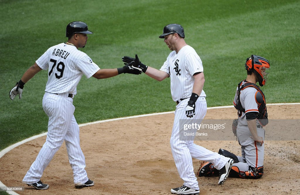 Adam Dunn #44 of the Chicago White Sox is greeted by Jose Abreu #79 after hitting a three-run homer against the San Francisco Giants during the fifth inning at U.S. Cellular Field on June 18, 2014 in Chicago, Illinois. The Chicago White Sox defeated the San Francisco Giants 7-6.