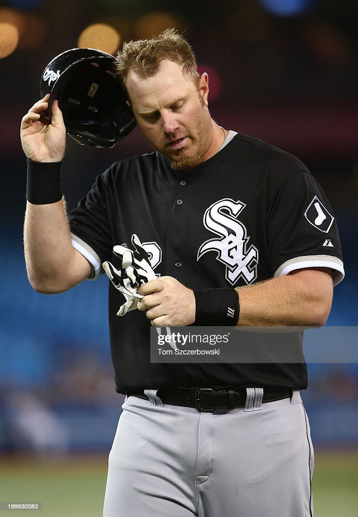 Adam Dunn #32 of the Chicago White Sox reacts after striking out in the seventh inning during MLB game action against the Toronto Blue Jays on April 18, 2013 at Rogers Centre in Toronto, Ontario, Canada.