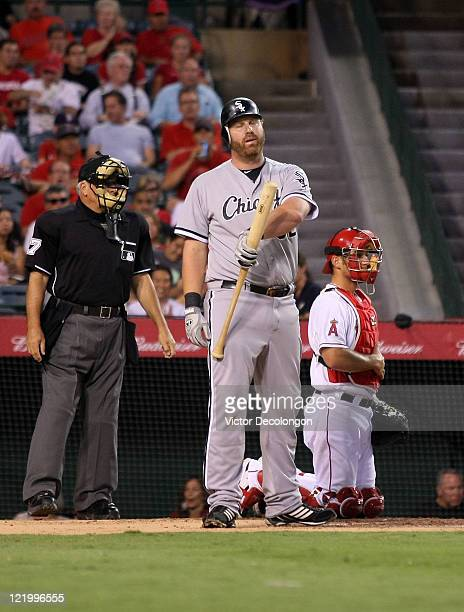 Adam Dunn of the Chicago White Sox reacts by twirling his bat after striking out in the second inning during the MLB game against the Los Angeles...