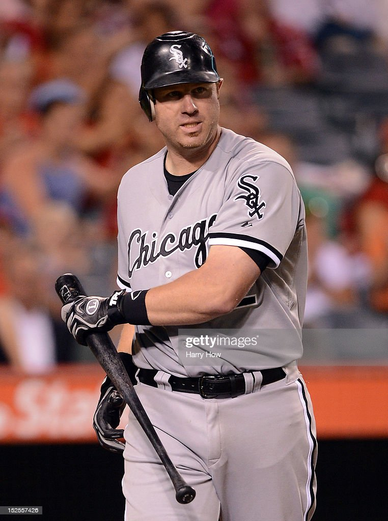 Adam Dunn #32 of the Chicago White Sox reacts to his strikeout with runners on base to end the eighth inning against the Los Angeles Angels at Angel Stadium of Anaheim on September 21, 2012 in Anaheim, California.