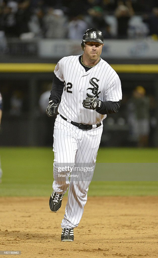 Adam Dunn #32 of the Chicago White Sox rounds the bases after hitting a three-run home run scoring Jordan Danks #7 and Kevin Youkilis #20 during the eighth inning at U.S. Cellular Field on September 24, 2012 in Chicago, Illinois. The White Sox defeated the Indians 5-4.