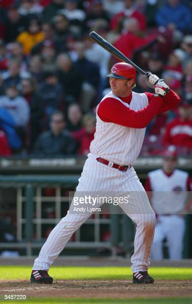 Adam Dunn of the Cincinnati Reds bats during the Reds home opening game against the Chicago Cubs on April 5 2004 at Great American Ballpark in...