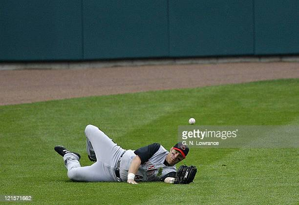 Adam Dunn of the Reds can't make the catch during action between the Cincinnati Reds and the St Louis Cardinals at Busch Stadium in St Louis Missouri...