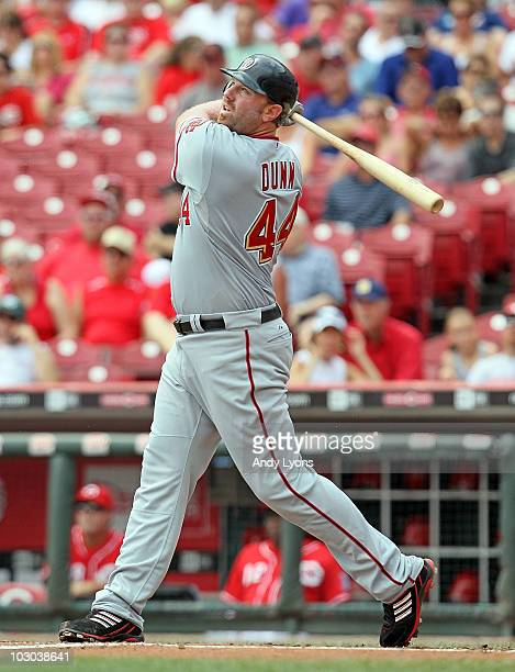 Adam Dunn of the Washington Nationals hits a home run during the game against the Cincinnati Reds at Great American Ball Park on July 22 2010 in...