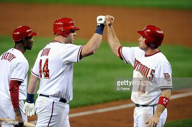 Adam Dunn of the Washington Nationals is congratulated by Ryan Zimmerman after hitting a home run against the Los Angeles Dodgers at Nationals Park...