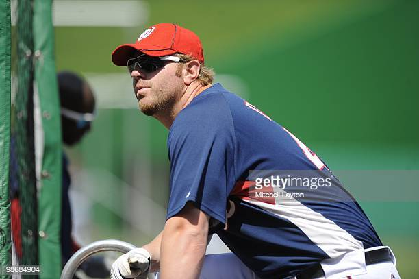 Adam Dunn of the Washington Nationals looks on during practice of a baseball game against the Colorado Rockies on April 22 2010 at Nationals Park in...