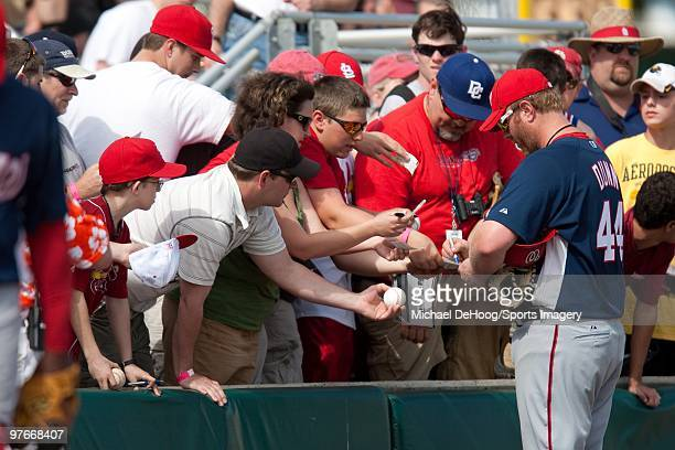Adam Dunn of the Washington Nationals signs autographs before a game against the St Louis Cardinals at Roger Dean Stadium on March 10 2010 in Jupiter...