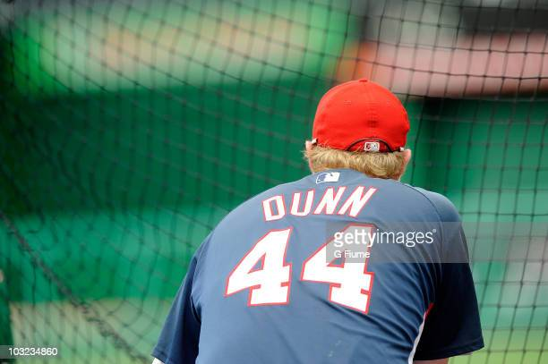 Adam Dunn of the Washington Nationals warms up before the game against the Philadelphia Phillies at Nationals Park on July 30 2010 in Washington DC