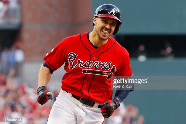 Adam Duvall of the Atlanta Braves celebrates after a two-run home run off Jack Flaherty of the St. Louis Cardinals in the seventh inning in game two...
