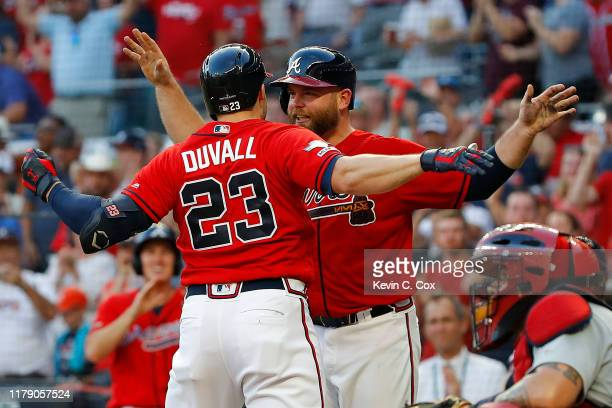 Adam Duvall of the Atlanta Braves celebrates with Brian McCann after a two-run home run off Jack Flaherty of the St. Louis Cardinals in the seventh...