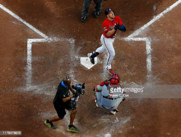 Adam Duvall of the Atlanta Braves crosses home plate after a two-run homer off Jack Flaherty of the St. Louis Cardinals in the seventh inning in game...