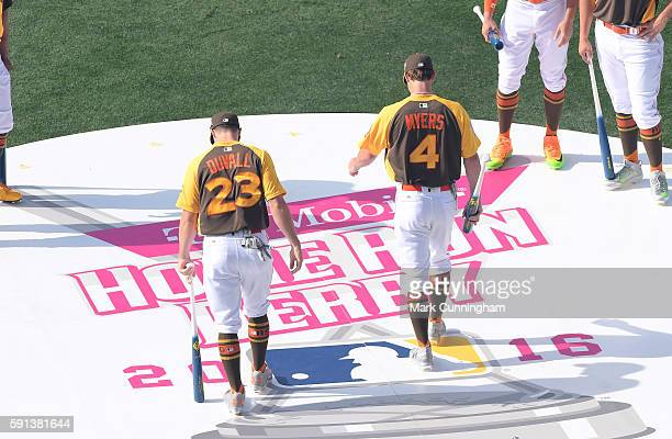 Adam Duvall of the Cincinnati Reds and Wil Myers of the San Diego Padres walk across the stage during player introductions prior to the 2016 TMoblie...