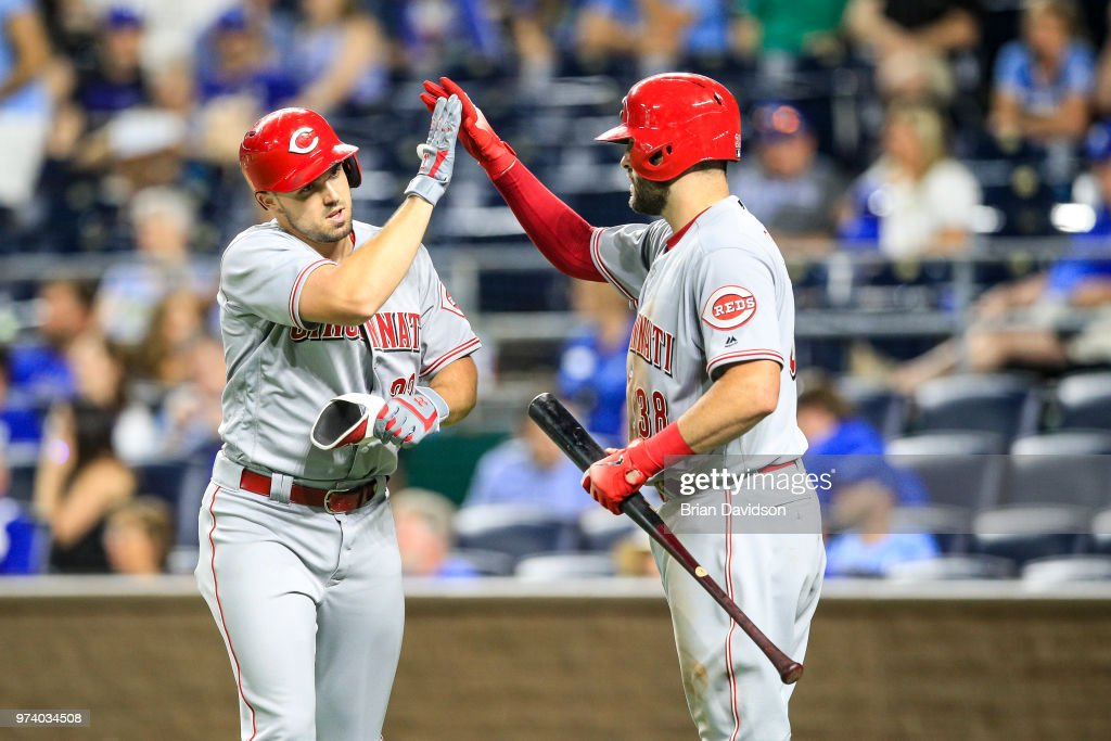 Adam Duvall #23 of the Cincinnati Reds celebrates hitting a grand slam home run with Curt Casali #38 in the ninth inning against the Kansas City Royals at Kauffman Stadium on June 13, 2018 in Kansas City, Missouri.