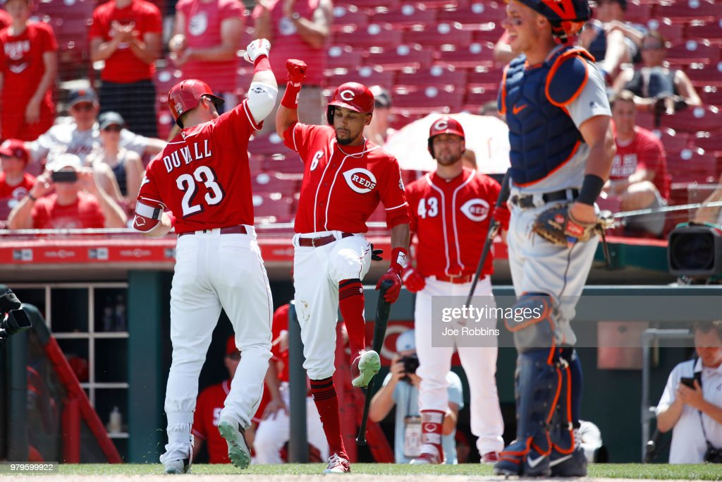 Adam Duvall #23 of the Cincinnati Reds celebrates with Billy Hamilton #6 after hitting a solo home run in the eighth inning against the Detroit Tigers at Great American Ball Park on June 20, 2018 in Cincinnati, Ohio. The Reds won 5-3.